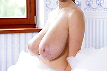 Busty Buffy Strips And Masturbates With Dildo In Bubble Bath