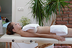 Busty Buffy On Massage Table Covered In Towels