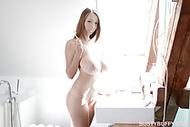 Standing nude in front of wash basin huge breasts