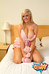Kneeling On Bed Wearing Lingerie Big Breasts Spilling Out Holding Teddy Bear Between Her Thighs