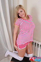 Kneeling On Chair Wearing Striped Top In Shorts