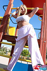 Standing In Playground Dungarees Pulled Down