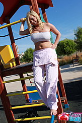 Standing Barefoot On Playground Equipment Hand On Hip Big Tits In Boob Tube