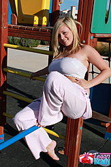 Seated In Playground Big Boobs In Boob Tube