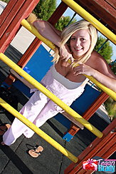 Leaning Against Bars In Playground Exposing Her Cleavage