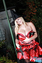 Tegan Brady with thumb in dress exposing big breast cleavage blonde hair under witch hat
