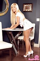 Tasha  bending over table long blonde hair denim short skirt high heels