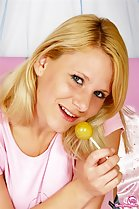 Blonde Lilian holding lollipop